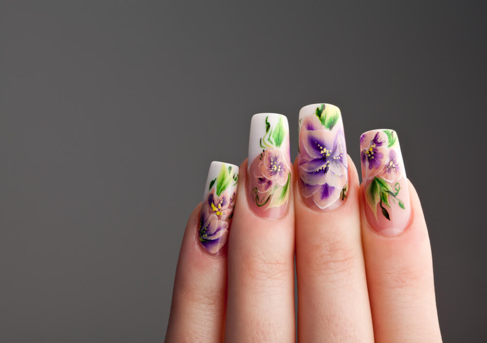 Fiberglass nails with nail extension designs consisting of spring-like flowers.
